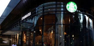 A man walks past a Starbucks shop in Sandton