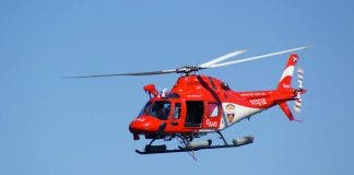 rescue helicopter searching for crayfish diver at betty's bay