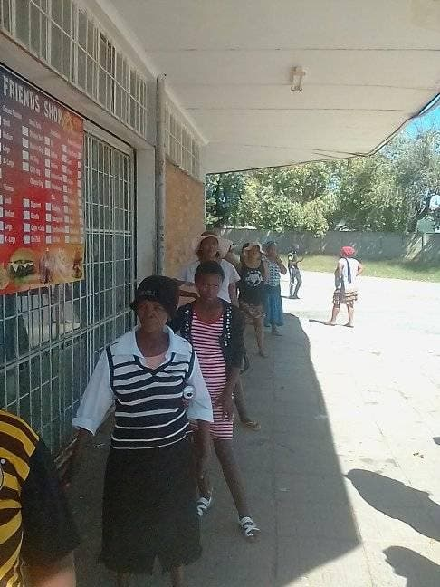 Locals line up for the food parcels in Virginia, Free State