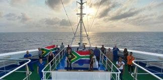 south africans aboard miami ship sing national anthem
