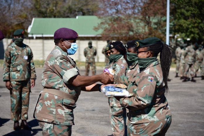 Lieutenant General R. Maphwanya handing over hygiene parcels to female officers, after which a near 324 female enlistees line up – Doornkop, Johannesburg.