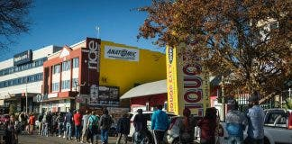 south africans queue alcohol bottle stores