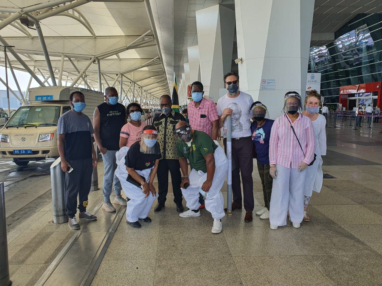 Members of the South African Commission in Delhi, pose for a photo following the successful repatriation of citizens (in joint effort with the Consulate in Mumbai).