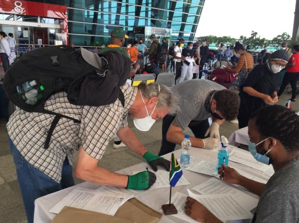 South African Citizens fill out mandatory paperwork before their departure – Delhi, India