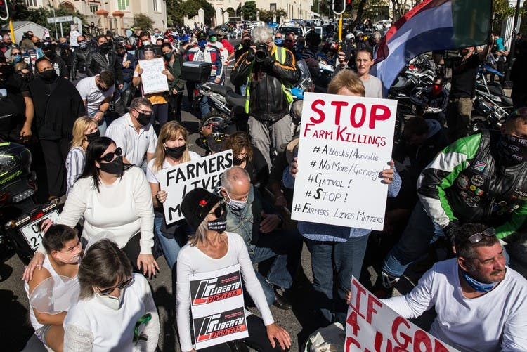 Hundreds of people, many on bikes, protested outside Parliament on Saturday morning against farm murders. Photo: Ashraf Hendricks