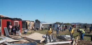Anti-land invasion unit members demolishing shacks in Bloekombos on Friday. Photo: Vincent Lali