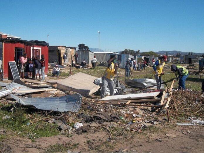 Anti-land invasion unit members demolishing shacks in Bloekombos on Friday. Photo: Vincent Lali