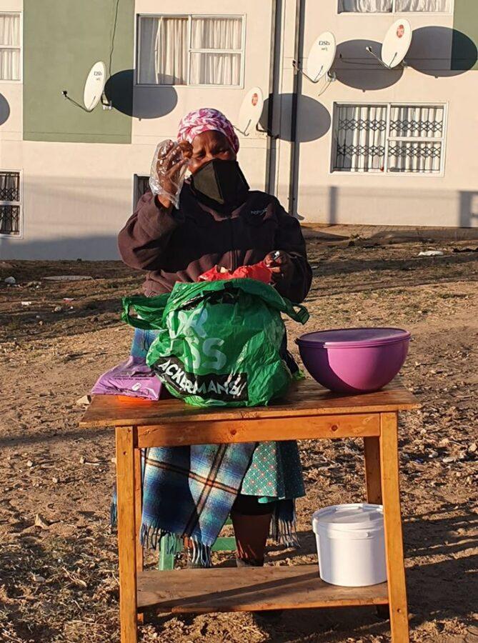 lady selling vetkoek curro school