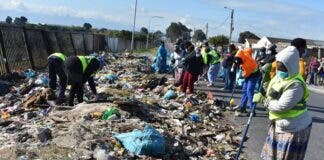 KTC community clearing 'dump site' near their homes on Friday. Photo: Buziwe Nocuze