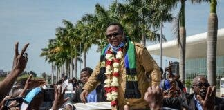 Tundu Lissu reacts to supporters as he returns home after three years in exile.