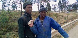 """""""We decided to help the people of Lusikisiki and ourselves,"""" says Siphiwe Mlonji (right). He and Lindani Mbotyeni (left) fix potholes on the R61 to Flagstaff. Photo: Sibahle Siqathule"""