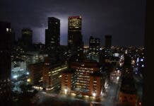 Johannesburg city skyline at night during thunderstorm and lightning