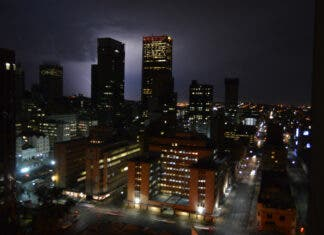 Johannesburg city skyline at night during thunderstorm and lightning