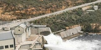 The Berg River Dam, which can hold 14% of Cape Town's water capacity, is full, so the sluice has been opened. Photo: Nathan Geffen