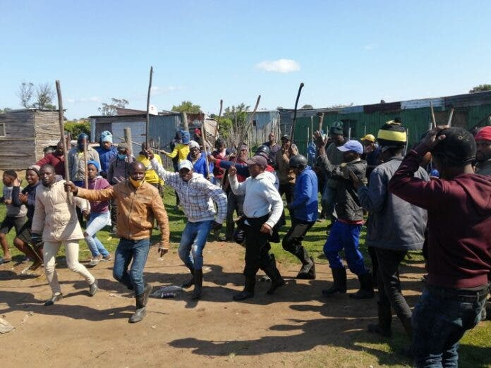 Some of the former employees of Dippin Blu Racing in Fairview, Port Elizabeth who stormed the stables in protest on Thursday, killing one horse and injuring over 20 others. Photo: Mkhuseli Sizani
