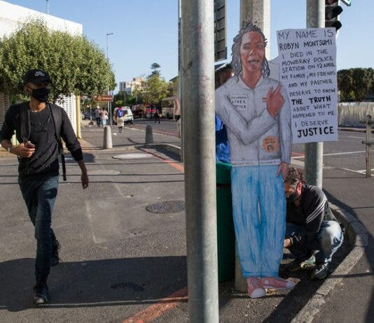 Clinton Osbourn created a life size portrait of activist and sex worker Robyn Montsumi. Montsumi died in police custody at the Mowbray police station. Photo: Ashraf Hendricks