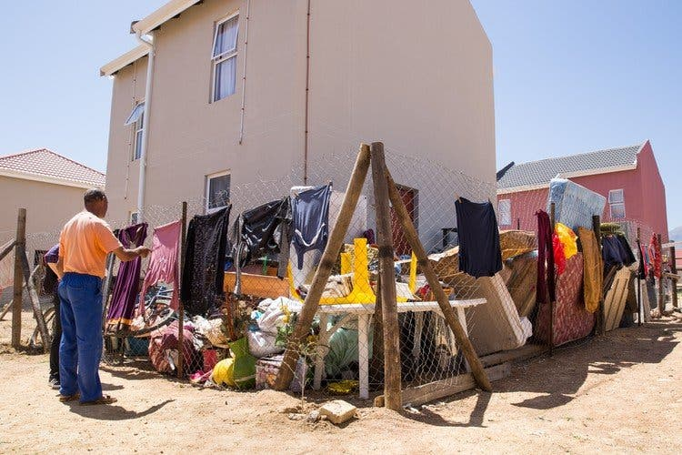 Most of the family's belongings are still stacked outside in the small yard since their eviction last week. Photo: Ashraf Hendricks