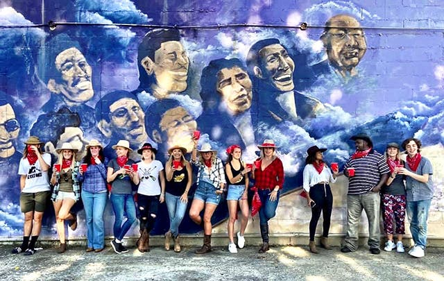 Friends of South Africa Nashville in front of Jimi Hendrix mural on Jefferson Street