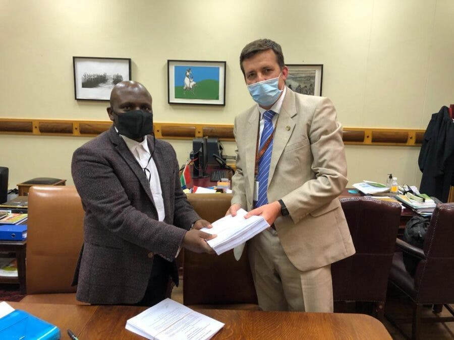 adrian roose handing over passport petition