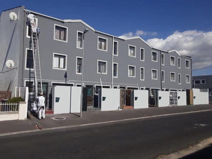 People involved in the refurbishing of Kensington Place hope that their project will inspire other communities to use the skills and services of unemployed people in their area. Photo: Supplied/Joseph Bruintjies