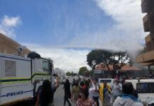 Hundreds of people queueing outside the SASSA offices in Bellville were doused with water by police after they were told to observe social distance on Friday. Photo: Mary-Anne Gontsana