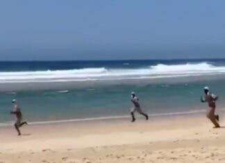 cops-chase-surfer-beach-south-africa