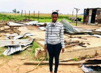 Sinoxolo Nwazi standing on the site of her demolished home. Photo: Kimberly Mutandiro