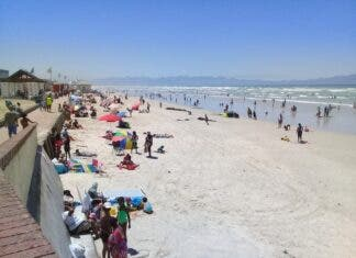 Muizenberg beach was busy after President Cyril Ramaphosa lifted the ban on beaches on Monday night. Photo: Marecia Damons
