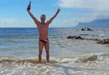 Ryan Stramrood celebrating after his record-breaking False Bay Crossing.