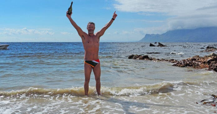 Ryan Stramrood celebrating after his record-breaking False Bay Crossing.