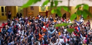 Over 150 UCT students protested in the Kramer Law Building on Friday against the financial exclusion of those who are unable to pay fees or who have historic debt. Photo: Ashraf Hendricks