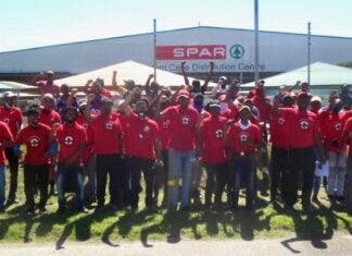 Striking workers gathered outside the Spar distribution centre in Perseverance, Gqeberha. The strike came after workers rejected the company's offer of a 3% pay increase. Photo: Joseph Chirume