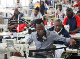 """People work at ''The Faktory"""", a fashion design and clothing manufacturing company in Johannesburg, South Africa, March 4, 2021. REUTERS/Siphiwe Sibeko"""