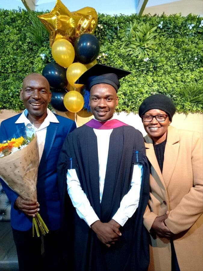 Photo of my parents and brother on his graduation in April
