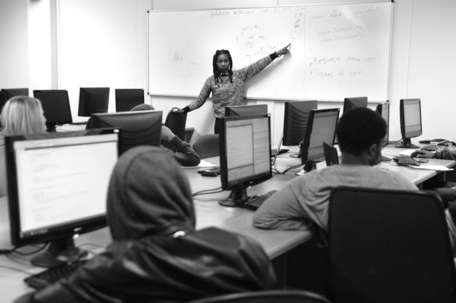 Photo of me tutoring first years, by Leonette Bower