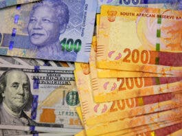 South African bank notes featuring images of former South African President Nelson Mandela (R) are displayed next to the American dollar notes in this photo illustration in Johannesburg , file. REUTERS/Siphiwe Sibeko