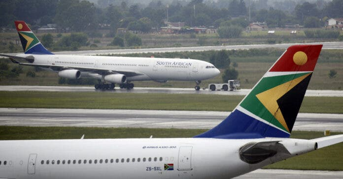 A South African Airways (SAA) plane is towed at O.R. Tambo International Airport in Johannesburg, South Africa, January 18, 2020. REUTERS/Rogan Ward/File Photo