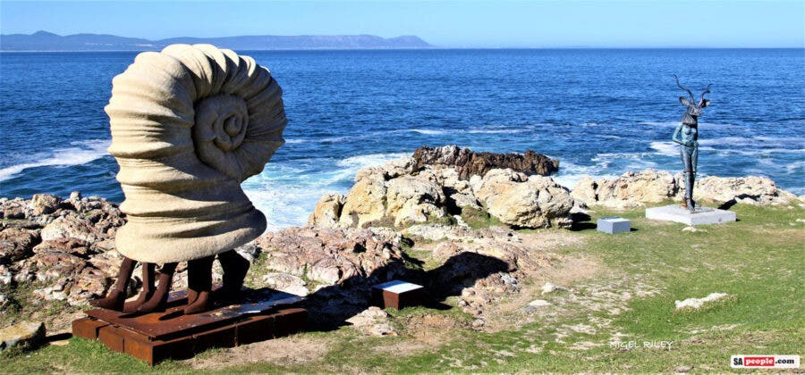 The Hermit Hermanus sculpture on the cliff