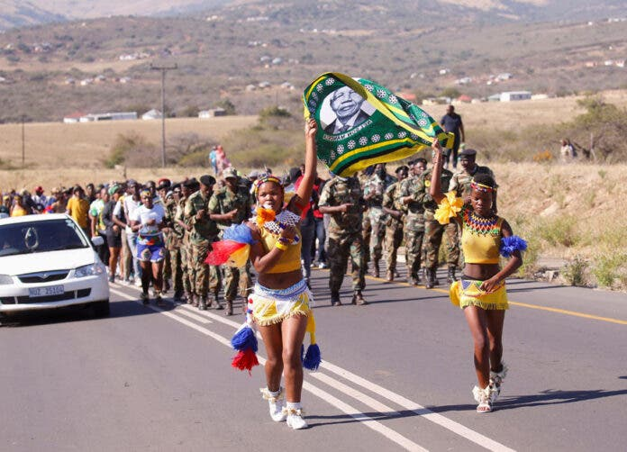 Supporters of former South African President Jacob Zuma walk to his home in Nkandla