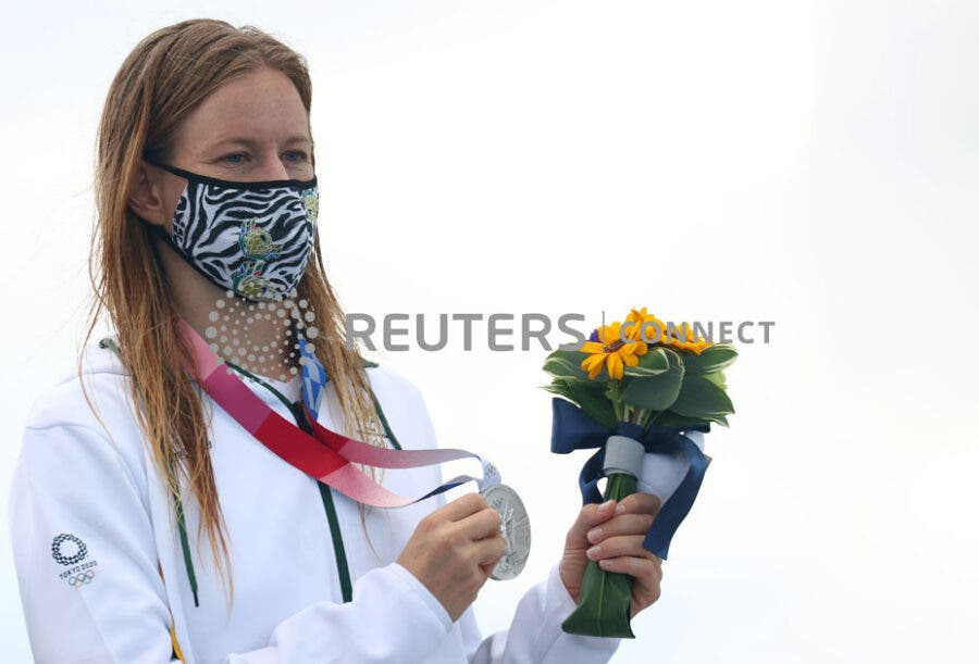 Tokyo 2020 Olympics - Surfing - Women's Shortboard - Medal Ceremony - Tsurigasaki Surfing Beach, Chiba, Japan – July 27, 2021. Silver medallist, Bianca Buitendag of South Africa wearing a protective face mask poses on the podium REUTERS/Lisi Niesner