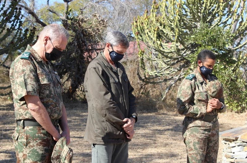 KNP Staff members observe the moment of silence in honour of Rangers who have departed