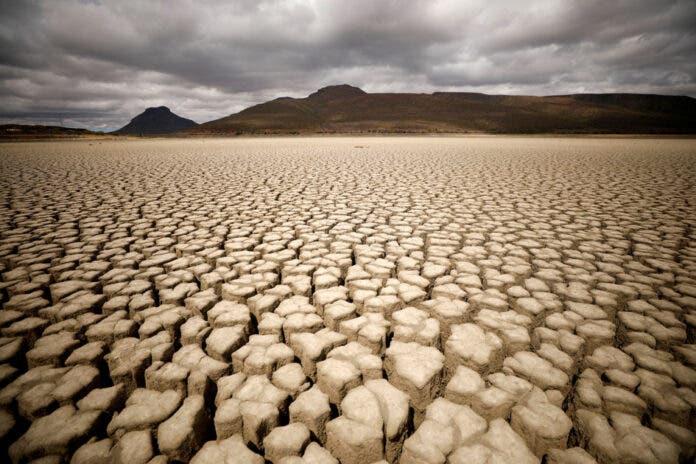 Clouds gather but produce no rain as cracks are seen in the dried up municipal dam in drought-stricken Graaff-Reinet, South Africa, November 14, 2019.