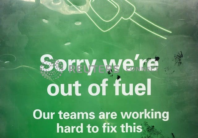 sign is seen at a BP petrol station that has run out of fuel in south London, Britain, September 27, 2021. REUTERS/Toby Melville