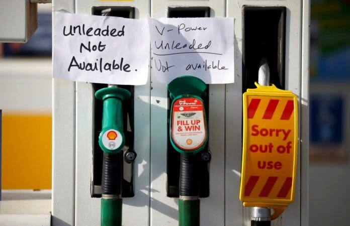 LONDON (Reuters) -Britain put the army on standby to deliver fuel from Tuesday after an acute shortage of truckers triggered panic buying that left fuel pumps dry across the land and raised fears that hospitals would be left without doctors and nurses.