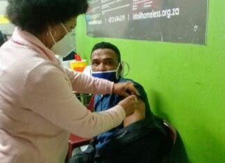 Cape Town centre offers a hot meal and a vaccine to homeless people
