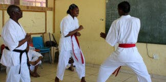 Sensei Mandla Nkonde (wearing a black belt) with students Oratwa Tsosane and Boipelo Mongale. During the week Nkonde works as a reclaimer and at the weekend he becomes sensei to over a dozen children who attend his karate classes in Orlando West, Soweto. Photos: Masego Mafata