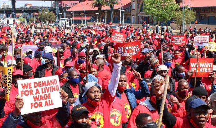 Hundreds of NUMSA workers marched from the Mary Fitzgerald Square to the Metals Engineering Industries Bargaining Council office in Marshalltown to hand over the memorandum of their demands on Tuesday. It was part of the national strike by steel engineering workers who are demanding an 8% wage increase, among other things. Photo: Masego Mafata