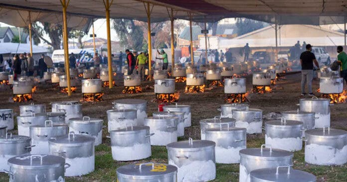 Food is prepared by a South African non-profit to feed over 87 000 people in underprivileged communities at the height of the COVID-19 pandemic in Cape Town in 2020. Photo by Brenton Geach/Gallo Images via Getty Images