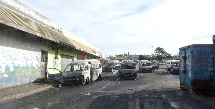 Several minibus taxis and a car were torched in Korsten, Gqeberha on Wednesday following violent clashes between taxi operators and local business owners. Photo: Joseph Chirume